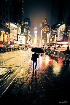 NYC. Dark man in a wet, bright night // Flickr:  by Joey Kennedy