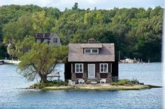a bitty cottage marooned in flowing water--the ultimate rural retreat--nobody can get there without a boat--hope the waters don't rise....