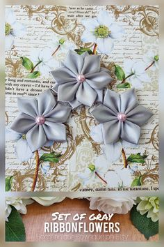 This is a listing for a beautiful set of 3 gray ribbon flowers made. The flower appliques, made from high quality satin ribbon and decorated with pink pearls in the center are perfect for any DIY project! Can be used for creating headbands, hair accessories, brooches, bouquets, corsages, mason jars, embellishing a scrapbook, making a greeting card or adding a special touch to a gift package. #crafts #flowers #ribbonflowers #diyprojects #etsyflowers