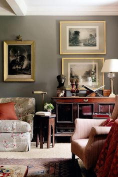 """The sofa and one armchair are covered in """"Opium Poppy Bright"""" linen, and to one side of the fire, another armchair is covered in 'Jardinieres Cotton' chintz; both fabrics are by Robert Kime, and are available through Sibyl Colefax & John Fowler. Like this? Then you'll love [link url=""""http://www.houseandgarden.co.uk/interiors/furnishings/top-50-best-chairs-for-the-home/""""]The 50 best Chairs for the Home[/link]"""
