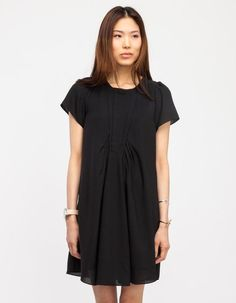 Wispy dress with fold-over bodice details. Features front and rear ruching, hidden back zip, brea...