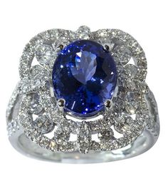Tanzanite, diamond and 14k white gold ring  centering one oval cut tanzanite measuring approximately 11.06 x 8.80 x 6.57 mm, weighing approximately 4.34 cts., accented by full cut diamonds weighing in total approximately 1.27 cts., set in a 14k white gold mounting, size 7, weighs 7.6 grams