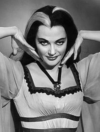 Lily Munster for my Halloween costume. See previous pin for more details. Necklace is black ribbon w/a bat pendant. Dress is ankle length.