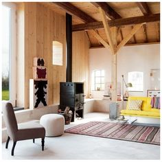Old, fresh, and modern. Love the yellow couch and fireplace.