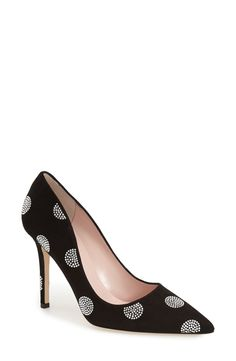 Crystalline polka dots dance across a sleek pointy-toe pump, while the low-cut vamp subtly shows off more skin, lengthening the line of the leg.