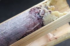 Khao Lam ข้าวหลาม  (Sticky Rice in Bamboo)    Sticky rice sweetened with black beans and syrup and roasted in a bamboo trunk