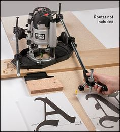 Router Pantograph. This works great for sign making. Just trace your stencil. It takes a little bit of practice but is easy to use. It will also do 3 dimensional items.