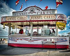 Funnel Cakes Stand – Virginia Beach Boardwalk. Virginia Beach is an independent city located in the state of Virginia. It is the most populous city in Virginia as well as the 39th most populous in the United States. It is located on the Atlantic Ocean at the mouth of the Chesapeake Bay.  The city is listed in the Guinness Book of Records as having the longest pleasure beach in the world. The boardwalk is three miles long.