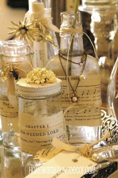 beautiful bottles, embellished with vintage papers & jewelry - from Deb at HOMEWARDfoundDecor.com