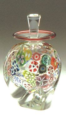 """Multi-Murrini Perfume Bottle"" Art Glass Bottle Created by Mary Mullaney and Ralph Mossman. Wafer-thin - a glorious bouquet encased in clear blown glass. Love the random pattern and choice of sizes, colors and shapes in the glass. Antique Perfume Bottles, Vintage Bottles, Bottle Vase, Glass Bottles, Glass Vase, Parfum Mademoiselle, Metal Nobre, Glas Art, Beautiful Perfume"