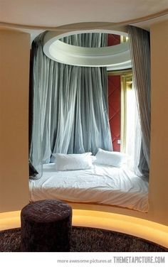 circle window bed.   I've dreamed this before. So glad to know it is a real thing that exists.