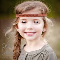 """The Leather Double Braid Boho Headband features a 13"""" long braided center, along with 15"""" of single strand leather along each end for tying. The leather is agreat choice to prevent slipping. Please allow for tiny differences from product photos, as each headband is handmade.    The lengths are perfect for girls of all ages, as the design goes almost all the way around on a young girls, and it is still long enough to go around and behind the ears on an adult!"""