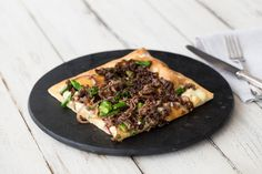 Beef, rosemary, and garlic are a match made in flavor heaven. Served atop crispy flatbread whit caramelized onions, gooey mozzarella, and tender broccoli, we guarantee you won't have any leftovers!