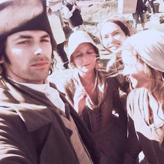 Aidan taking a selfie with some extras.