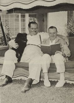 Laurel and Hardy. They had a Deep Friendship. Here they are Together with each other and with a Black Chow.
