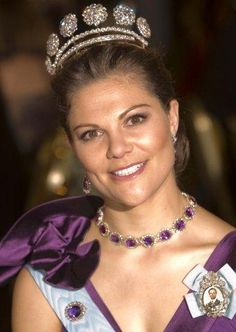 Crown Princess Victoria of Sweden. Victoria wearing an amethyst necklace, with the impressive Six Button Tiara, which has gotten larger in recent years with the addition of two rows of diamond chains at its base.