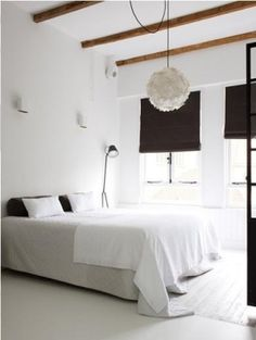 Black curtains in a white bedroom