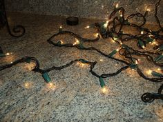 An easy to do project with a string of twinkle lights and a large bottle:  - 1 large bottle - 1 string of twinkle lights - Blue paint, black spray paint - Black…