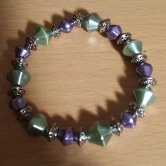 "Purple and Sage Stretch Cord Bracelet  7"" $10"