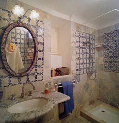 Marble and majolica tiles form the walls of the master bath. Working with local craftsmen for the entire renovation, Pes found that age- old Tunisian decorative traditions for precision and detail were still alive and well.