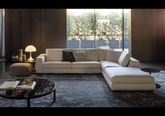 White Leather Modular Sofa Along With Round Black Marble Minotti Huber Coffee Table And Black Carpet Under Sofa For Best And Cool Minotti Huber Coffee Table Design