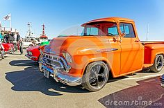 Kragero, Norway, 4 April 2015: Chevrolet 3100 in orange at Exhibition of old cars small town on the coast of the Norwegian fjord.