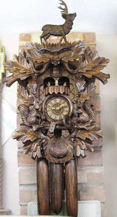 large carved wooden cuckoo clock