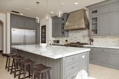 loving large kitchen islands (& this spacious kitchen) -- and the marble top (Long Top Design)