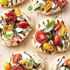 ... in the Round | Grilled Tomato-Basil Pizzettes | CoastalLiving.com