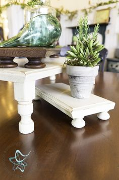 How to easily repurpose old drawer fronts into decorative risers by adding wood knobs and decorative spindels. by DeDe Bailey