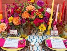 Fun yellow and fuchsia wedding tablescape with orange and purple details | 11 Colorful Fiesta Inspired Weddings via @IBTblog