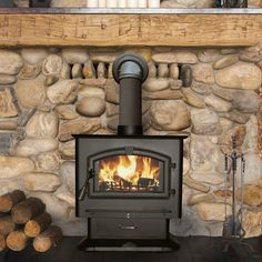 Beautiful stone firewall for woodstove