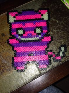 Cheshire cat perler beads by Dezzy Veasey