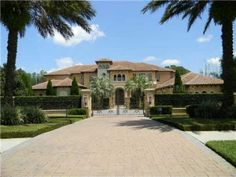Love the whole front yard to this home. Neatly trimmed grass, trees, and a gate. Very nice!