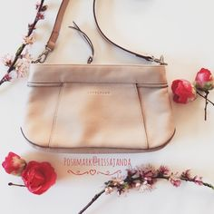 "Longchamp Nude Leather cross-body bag Smooth calf leather with silver polished hardware. Color : Nude. Adjustable & removable cross body strap. Interior divider and zip pocket. Logo jacquard lining. Measurements approx : 10""L x 5""H x 2""D. 24""-26"" cross body strap drop. Longchamp Bags Crossbody Bags"