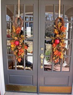 wreaths on double front doors