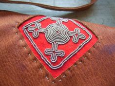 Tin thread embroidery detail on Saami leather bag Viking Embroidery, Embroidery Works, Thread Art, Textile Art, Handicraft, Pewter, Leather Bag, Tin, Cuff Bracelets