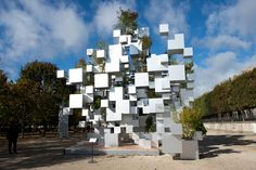 suo fujimoto adds greenery to layered cube installation in paris