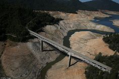 After: Here, the Enterprise Bridge spans the same reservoir, which has dwindled to a mere ...