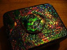 Another paper box covered with my fantasy film and UTEE. Love the colors in this one! The piece on top was cut from a CD then covered like the box, and then I used some copper tape around the edge, meant for stained glass..