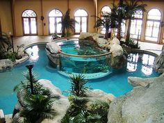 aquarium in the indoor pool. If the aquarium shatters, you're gonna end up with fish in the pool. Then the fish will die from the pool chemicals. Thanks a lot. Indoor Swimming Pools, Swimming Pool Designs, Backyard Pools, Lap Swimming, Pool Landscaping, Lap Pools, Pool Decks, Indoor Pond, Backyard Plants