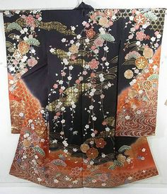 This is a Kimono silk fabric cut into Furisode shape and stitched roughly before sewing to make Furisode.  It has gorgeous 'Koushi' (lattice), Matsu (pine tree), 'Ume' (plum blossom) and 'Kaede' (maples) on Kagome 'basket' pattern, which is dyed colorfully against black base color.