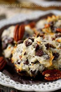 """If you love quick and easy treats, these 4-ingredient Chocolate Pecan Coconut Cookies are for YOU! No mixer, no chilling, this """"cookie dough"""" is ready to go in just seconds and the cookies bake up to..."""