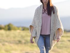 Oh my - I am SO excited to share this new crocheted blanket cardigan with you today! Of all of the blanket sweaters that I've made, this one is quite possibly the coziest and most comfortable EVER. In fact, when Lion Brand Yarn contacted me about making two projects for their 12 weeks of Christmas series, I just knew that I wanted to try and make the warmest and most wearable blanket sweater yet. In order to do that, I decided to use super bulky yarn (my fave!), a large hook and a text...