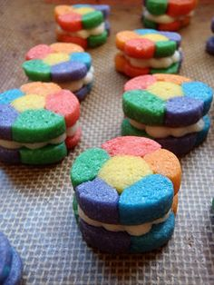 Aren't these rainbow sandwich cookies lovely! I know I love the classic sugar cookie with frosting. This is the same thing, but reversed. Instead...