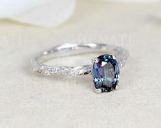 oval alexandrite engagement ring. Nature inspired twisted band with leaves and alexandrite . Perfect as a unique and original engagement ring.  Center stone: Is a oval high quality alexandrite gemstone size 8x6. Approx. 1.4 carat round cut. Alexandrite Engagement Ring, Leaf Engagement Ring, Alternative Engagement Rings, Opal Wedding Rings, Wedding Ring Bands, Bridal Earrings, Bridal Jewelry, Types Of Gemstones, Big Rings