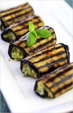 Grilled eggplant roll-ups with ricotta pesto-- 2 med eggplants, 2 tbsp. EVOO, ½ c ricotta, ¾ c pesto, 2 tsp lemon juice. Slice eggplants lengthwise (about 6 slices ea) brush w/oil, GRILL on stovetop pan ea side. MIX cheese, pesto, lemon juice. SPREAD heaping tbsp of mixture evenly over ea slice. ROLL up the slices, place on a plate seam-side, serve immediately.