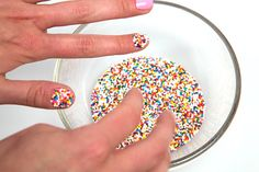 Learn how to create a sprinkles caviar nail! This fun DIY at-home manicure is a great nail art idea for kids.