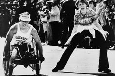1977 Bob Hall competes in the Boston Marathon. He was the first to complete the race in a wheelchair in 1975. B*