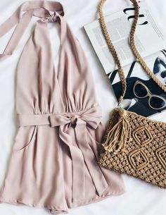 For a flirty night look this spring, try a blush romper with tie detail. Let Daily Dress Me help you find the perfect outfit for whatever the weather! dailydressme.com/